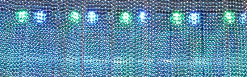 Rideaux de perles éclairés